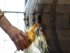 Sampling bourbon from the cask
